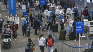 Travelers at San Francisco Airport. Photo by Bloomberg