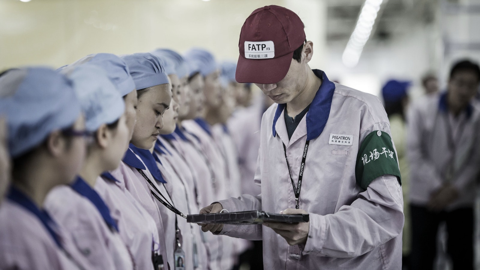 Workers at a Pegatron Corp. factory in Shanghai, China in 2016. Photo by Bloomberg