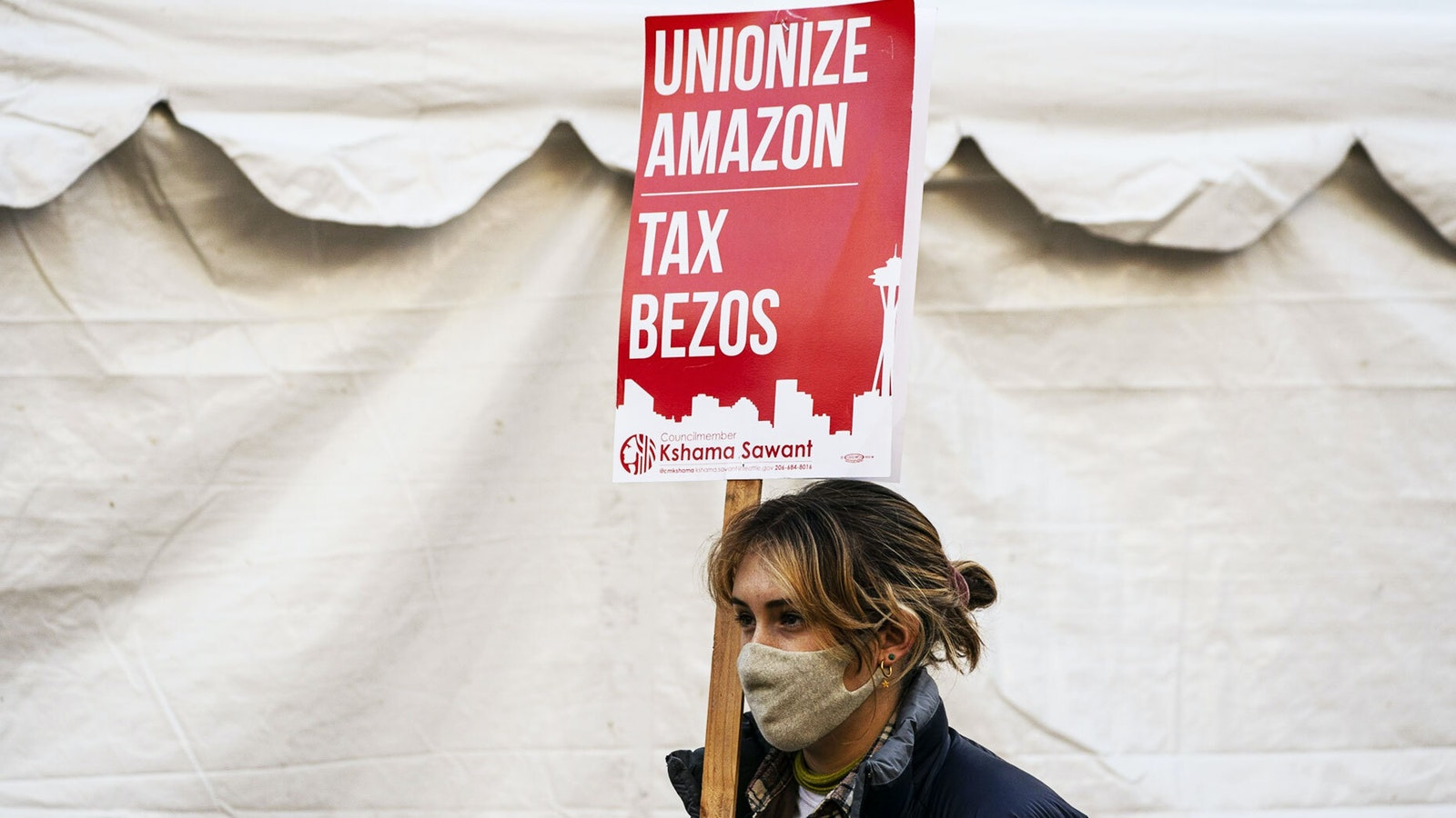 A demonstrator protesting outside Amazon's headquarters in Seattle in November. Photo by Bloomberg