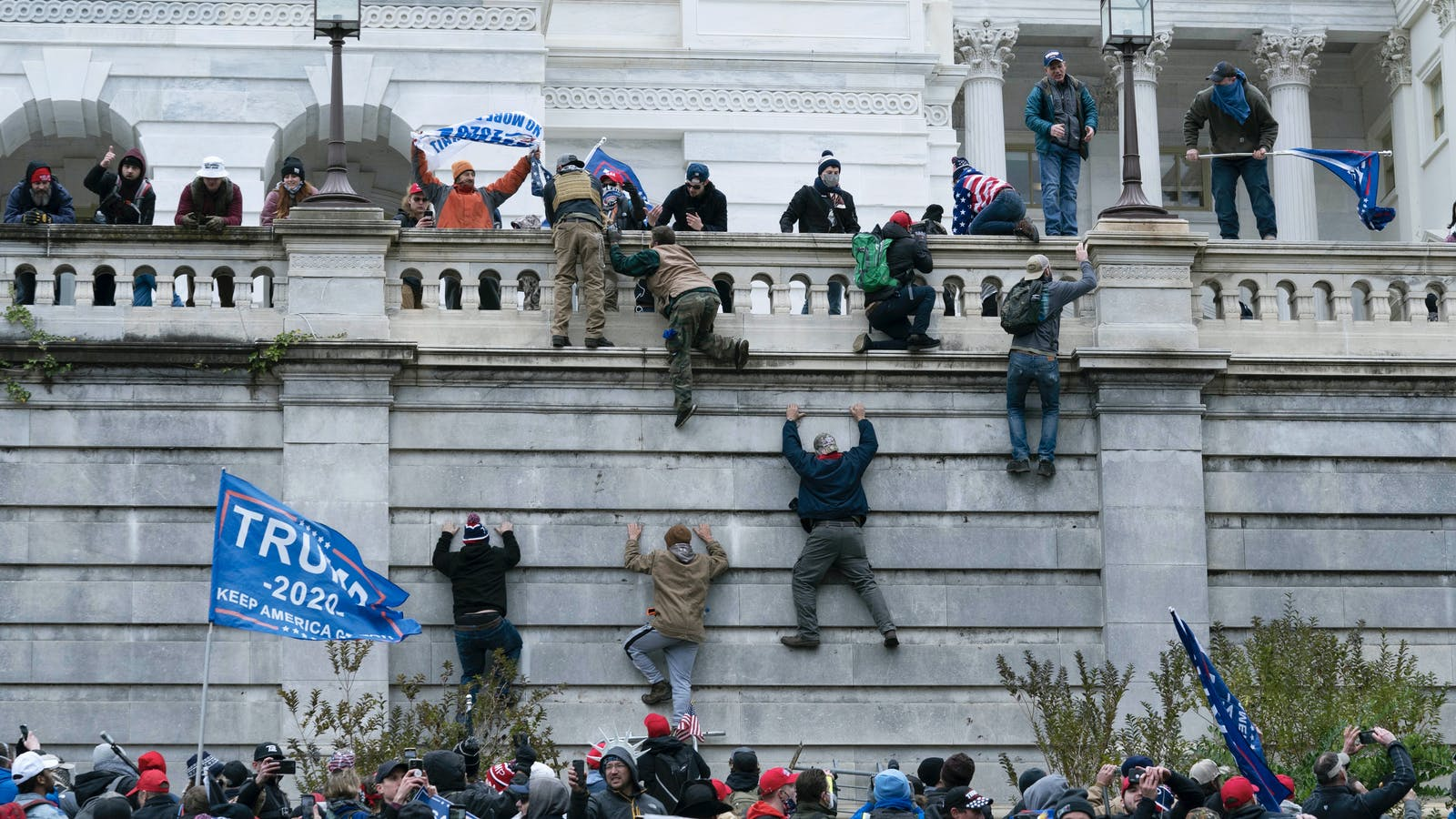 Protesters storming the Capitol building. Photo by AP