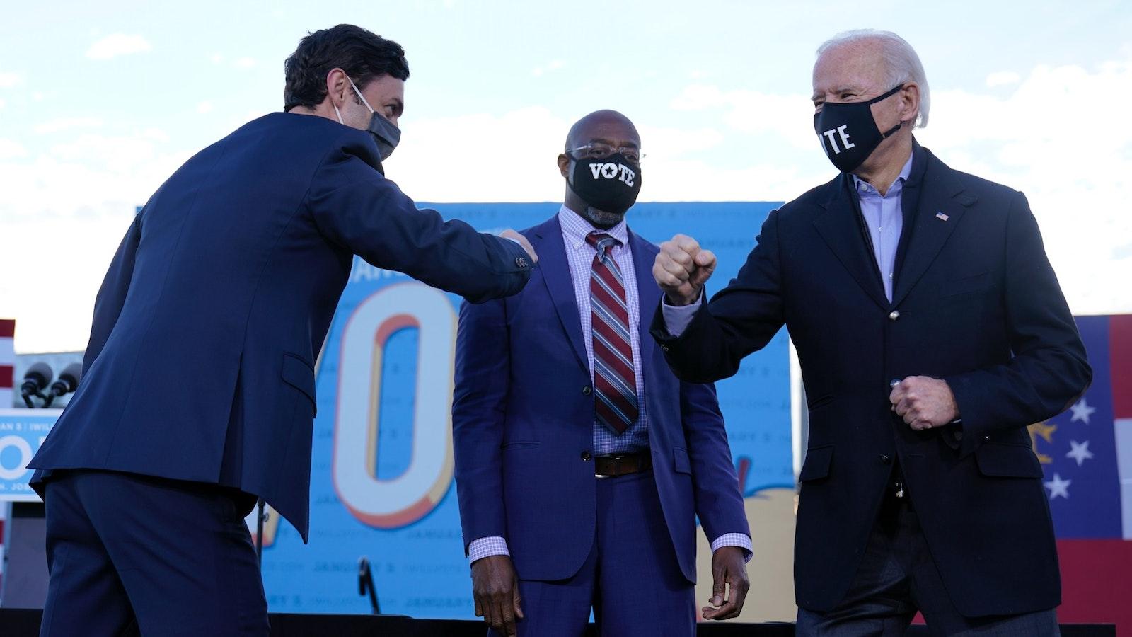 President-elect Joe Biden campaigned in Atlanta on Monday with then-Senate candidates Raphael Warnock, center, and Jon Ossoff, left. Photo: AP