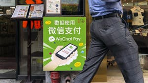 An advertisement for Tencent's WeChat Pay displayed outside a restaurant in Hong Kong last September. Photo: Bloomberg