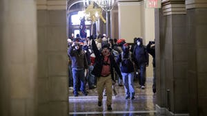 Rioters breached barricades to enter the U.S. Capitol  on Jan. 6. Photo: Bloomberg
