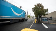 A truck next to an Amazon delivery station in New Jersey in October. Photo by Bloomberg