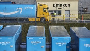 A truck and trailers outside an Amazon fulfillment center in Poland. Photo by Bloomberg