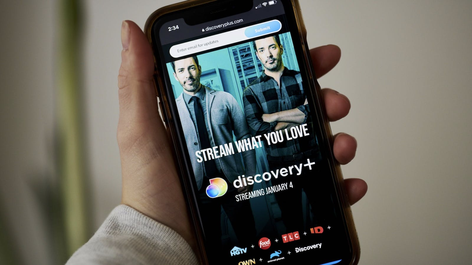 The Discovery+ home screen on a smartphone. Photo by Bloomberg