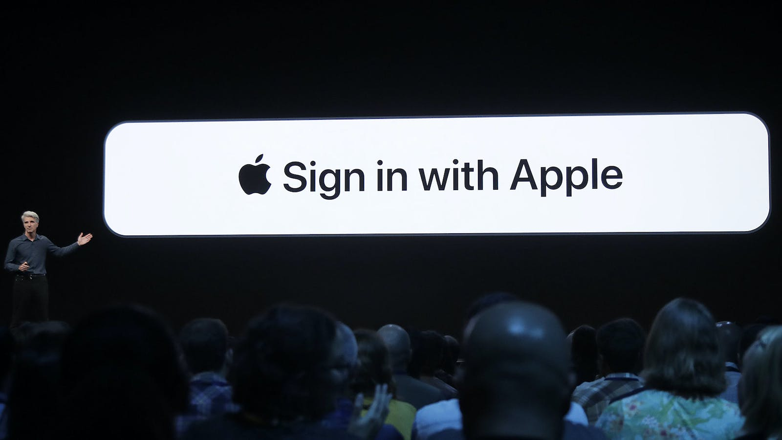Craig Federighi, Apple's senior vice president of software engineering, unveils Apple's sign-in button in 2019. Photo by AP.