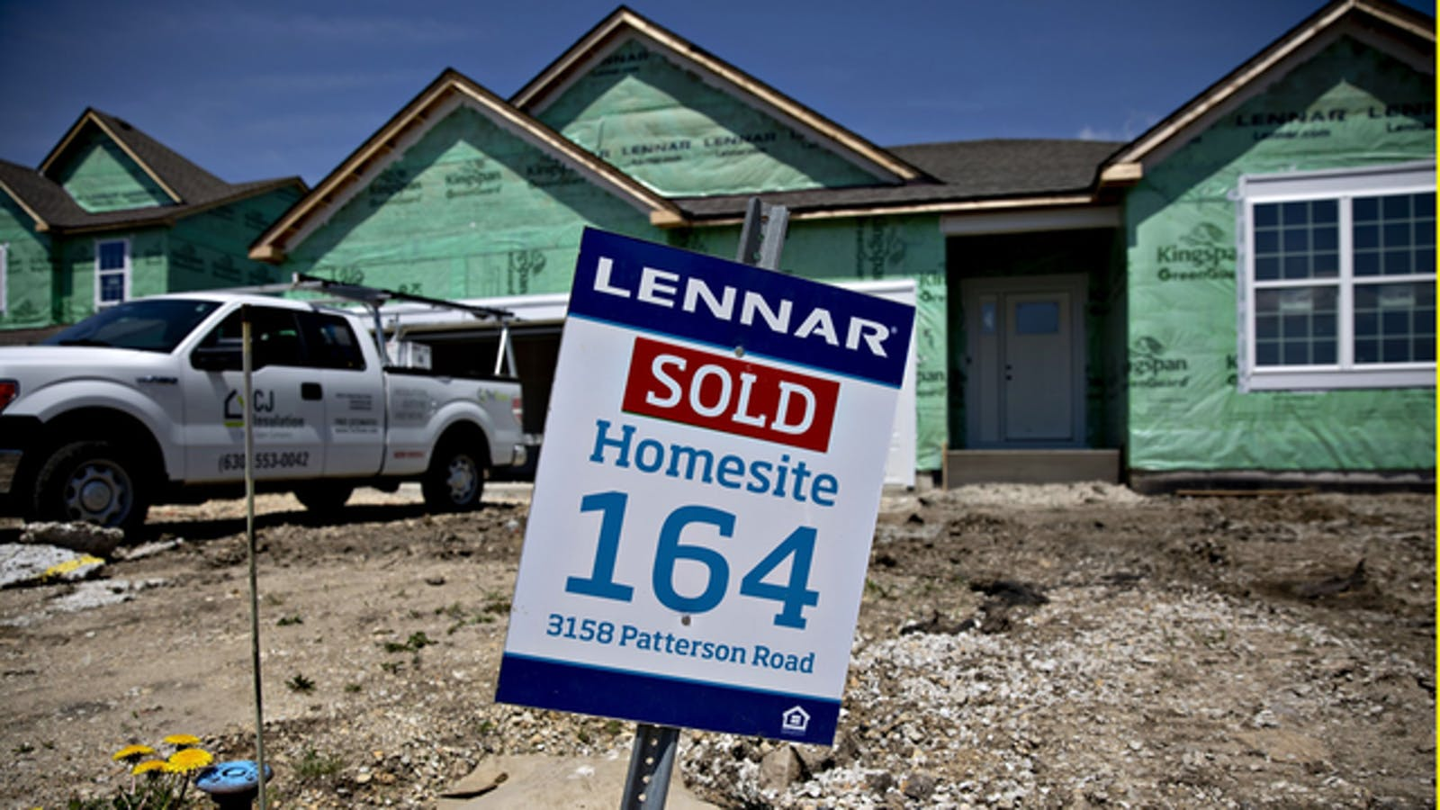A 'Sold' sign is displayed outside a home under construction at a Lennar development site. Photo by Bloomberg
