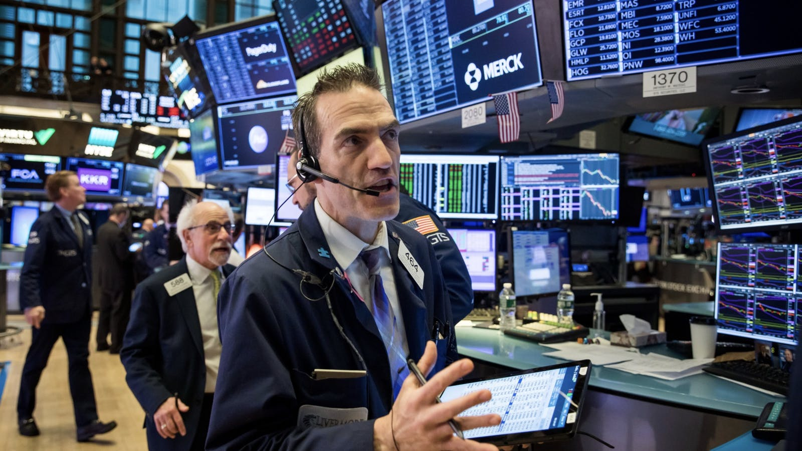 Traders on the floor of the New York Stock Exchange. Photo by Bloomberg.