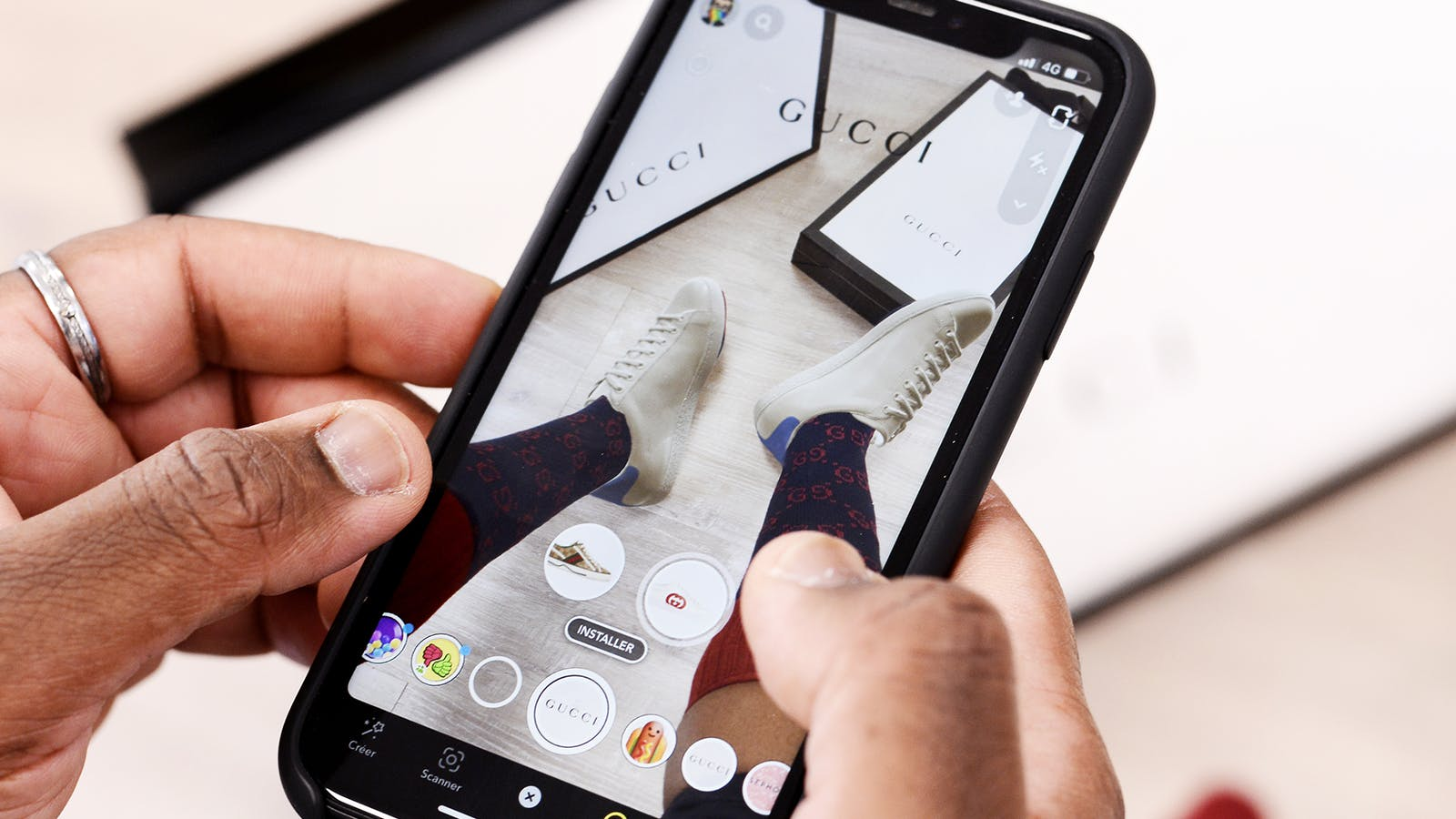 A screenshot of a recent Snapchat augmented reality feature that lets users virtually try on Gucci sneakers. Photo provided by Snap