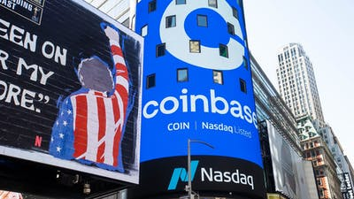 Coinbase signage at the Nasdaq in New York. Photo by Bloomberg.