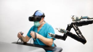 A rendering of a surgeon using a VR headset. Image: Vicarious Surgical