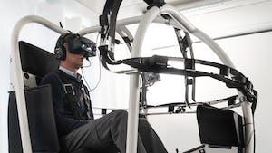 A pilot in a VRM Switzerland VR helicopter trainer. Image: VRM Switzerland