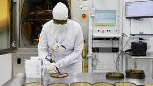 A cleanroom worker in an II-VI laser components factory. Photo: Apple