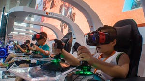 Children played virtual reality games during an exhibition in Guangzhou, China, in 2017. Photo: AP