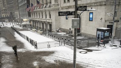The New York Stock Exchange during a winter storm. Photo by Bloomberg
