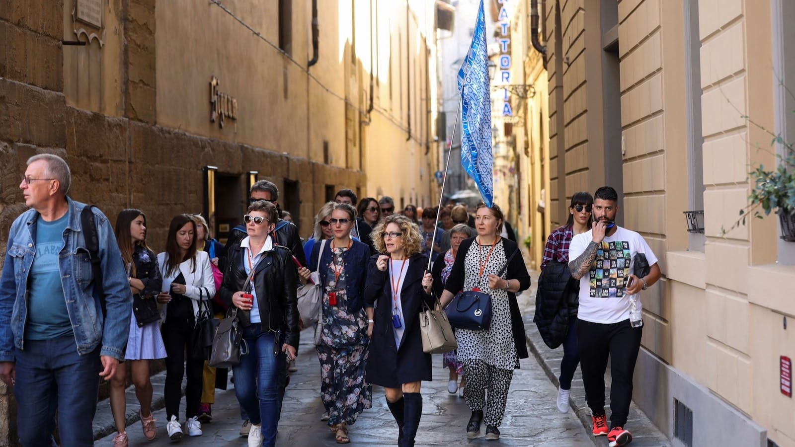 Tourists followed a tour guide through a backstreet in Florence, Italy, in 2017. Photo: Bloomberg