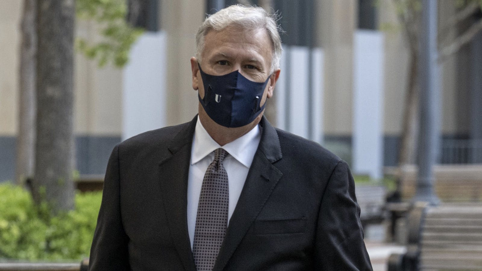 Phil Schiller arriving at court last week. Photo by Bloomberg.