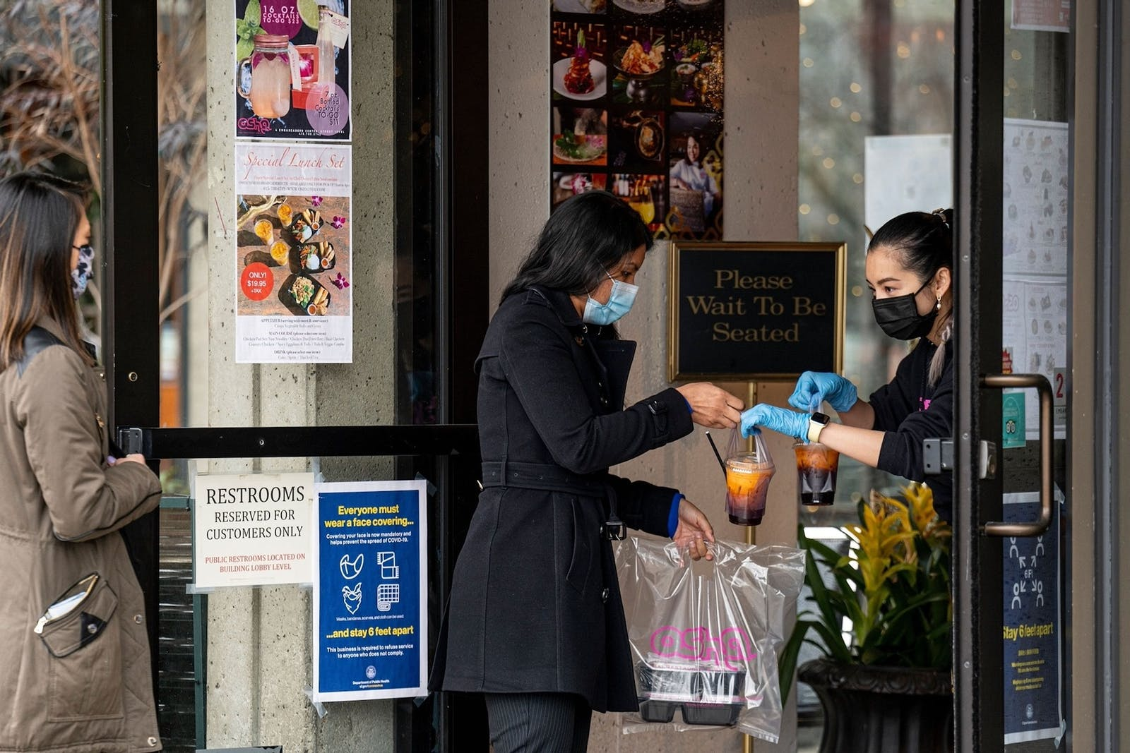 A restaurant in San Francisco serves a take-out customer in February. Startups that help restaurants take online orders have flourished during the pandemic. Photo: Bloomberg