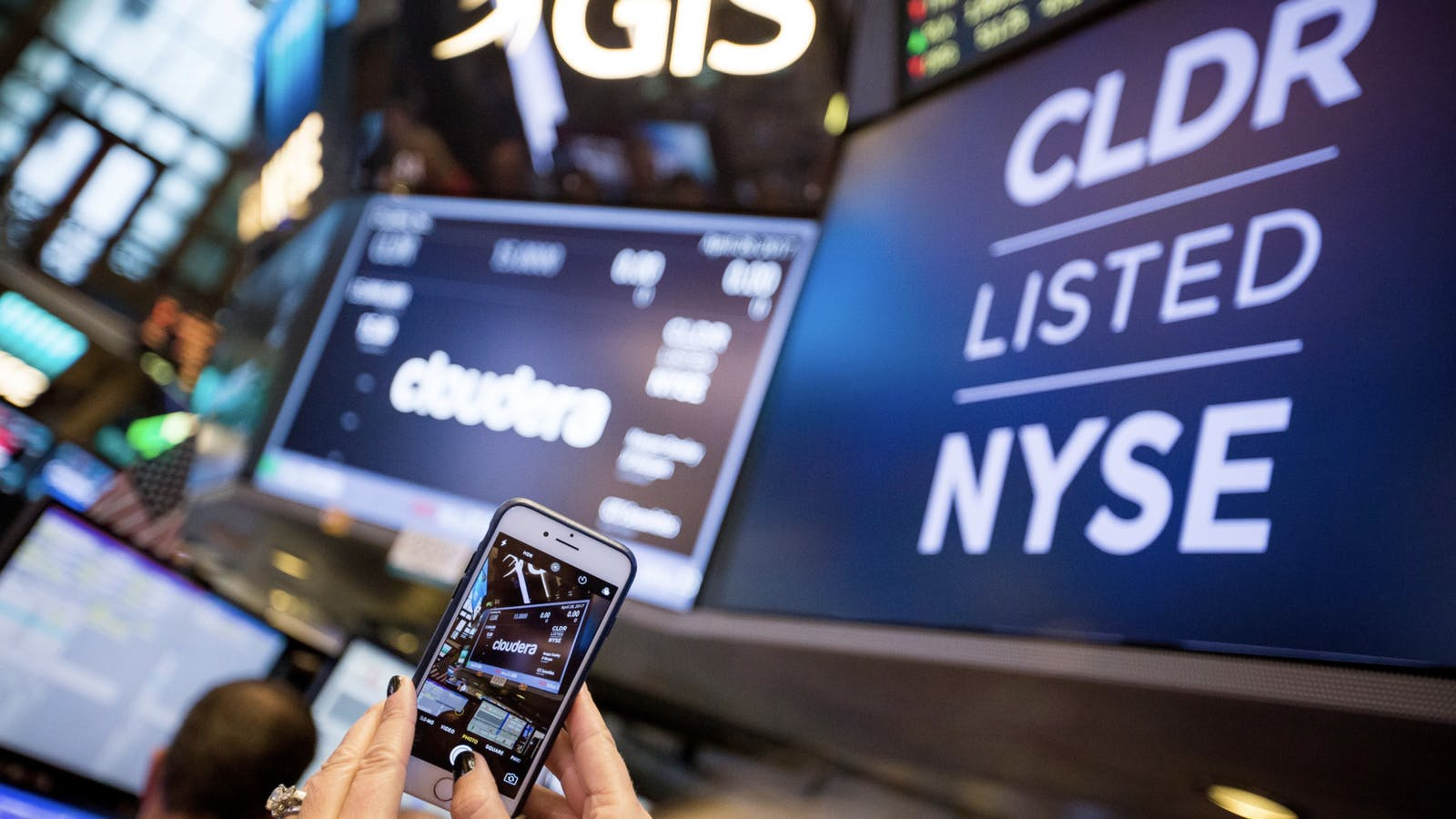 Someone taking a photo of Cloudera signage when the company went public at the New York Stock Exchange in 2017. Photo by Bloomberg