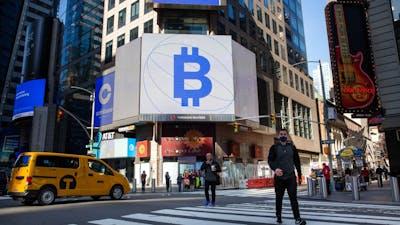 Monitors display Coinbase and Bitcoin signage at the Nasdaq in NYC. Photo by Bloomberg
