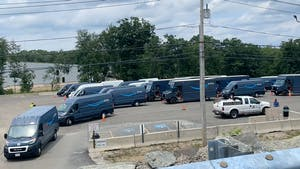 Amazon vans departing a new staging lot outside an Amazon delivery station in Milford, Mass. Photo by Paris Martineau