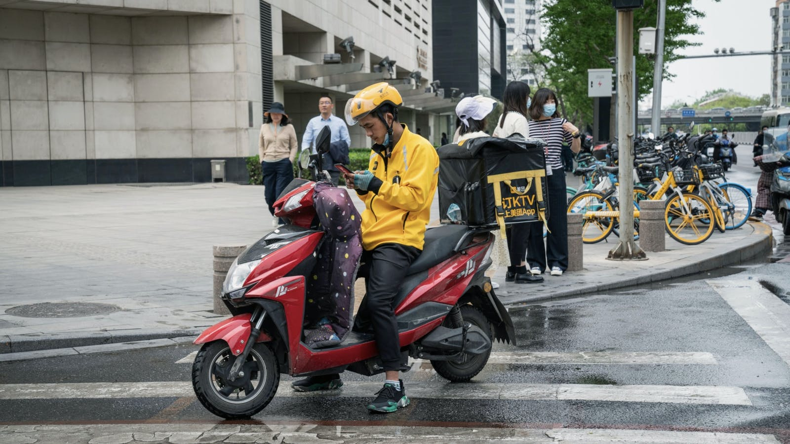 A Meituan food delivery courier in Beijing in April. Photo by Bloomberg.