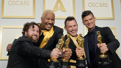 """Producers of Group Nine's short film """"Two Distant Strangers"""" at the Oscars. Photo by AP."""