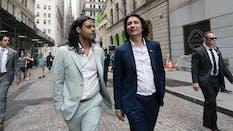 Robinhood co founders Baiju Bhatt, left, and Vladimir Tenev, walk on Wall Street following their company's IPO. Photo by AP