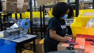 An Amazon worker at a company warehouse in Raleigh, North Carolina, in June. Photo by Bloomberg