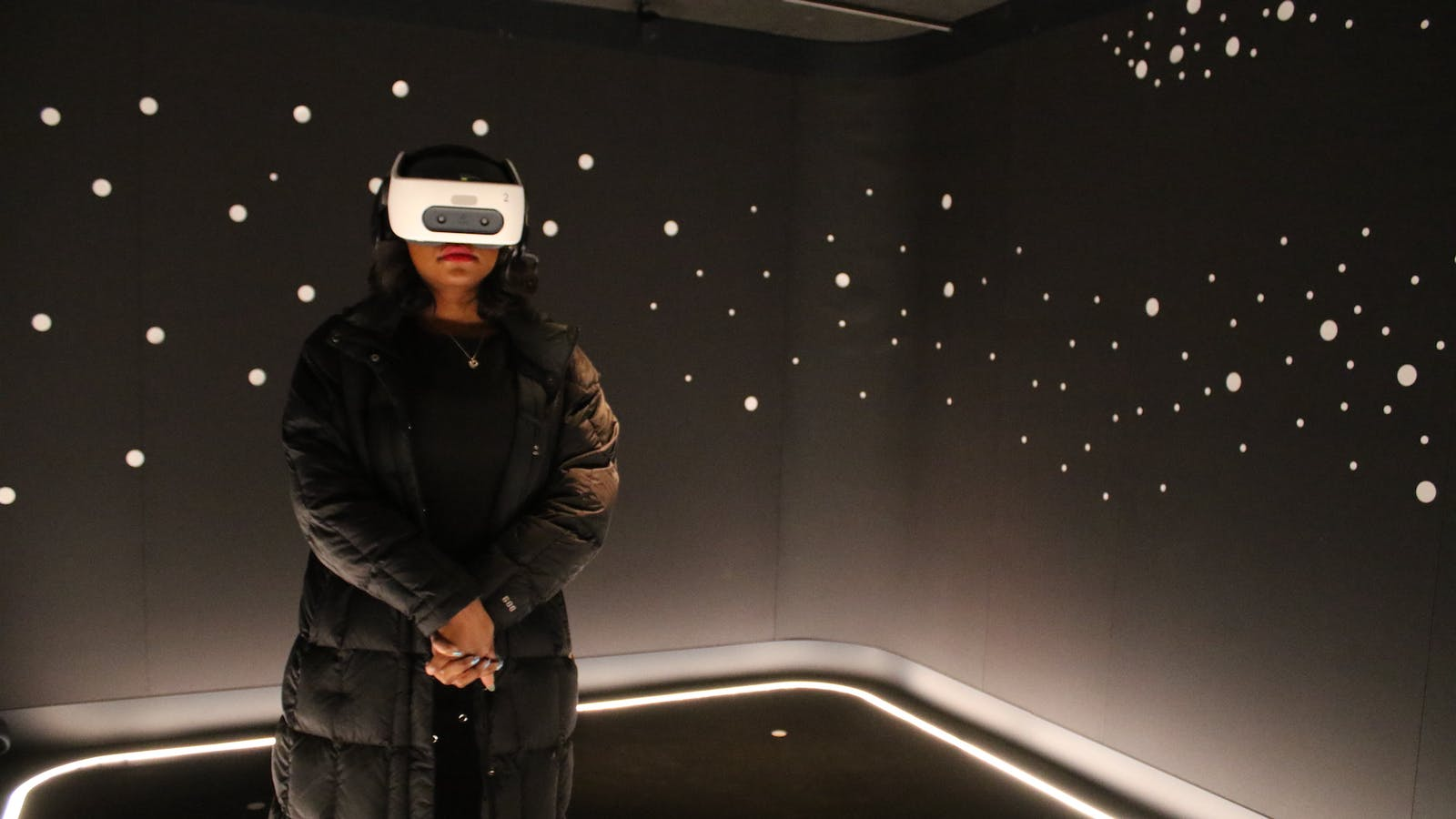 """A vistor to the DuSable Museum watches the """"I Have a Dream"""" speech presented in VR. Photo by AP."""