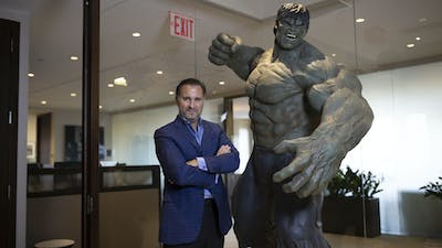 Redbird's Gerry Cardinale next to a statute of the Incredible Hulk. Photo by Bloomberg