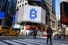 Coinbase and Bitcoin signage in New York this April. Photo by Bloomberg
