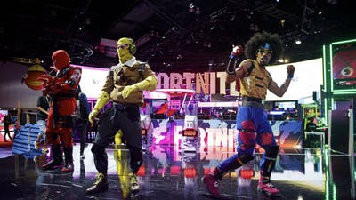 Character actors from Fortnite  dance during the E3 Electronic Entertainment Expo in Los Angeles in 2019. Photo by Bloomberg.