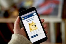 The Dogecoin website on a smartphone. Photo:Bloomberg
