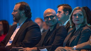 Salesforce CEO Marc Benioff, left, and Microsoft CEO Satya Nadella, middle, at Dreamforce on Wednesday. Photo by Bloomberg.